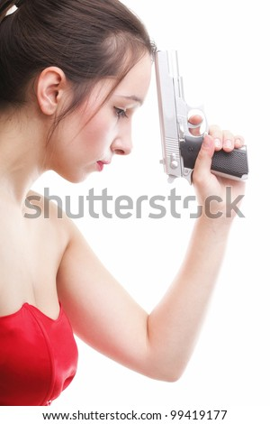 Sexy young woman in red with a gun isolated on white - stock photo