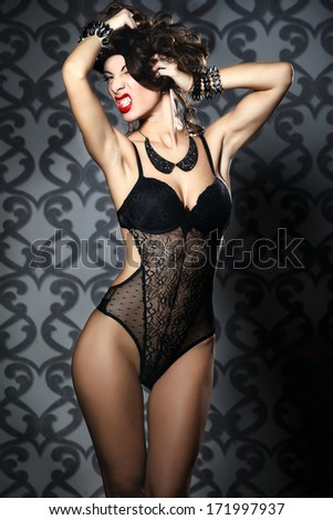 Sexy young woman posing in flirty lingerie - stock photo