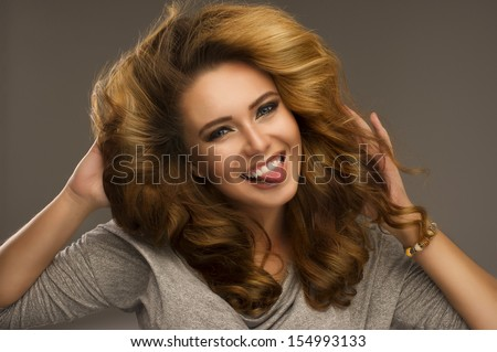 Sexy young woman smiling - stock photo