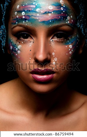 sexy young woman with creative face art like under water - stock photo