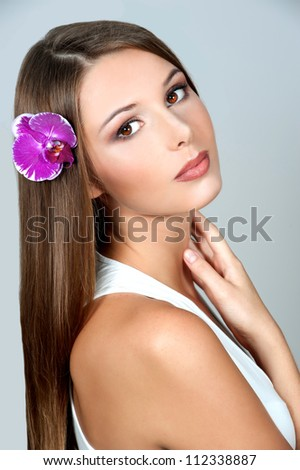 Sexy young woman with flowers - Beautiful portrait of a sexy woman with bright pink flowers - stock photo