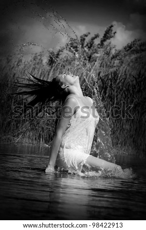 Sexy young woman with fluttering hair - stock photo