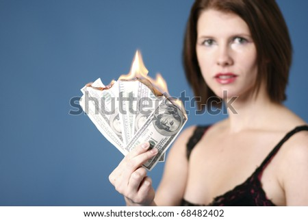 Sexy young woman with money to burn. - stock photo