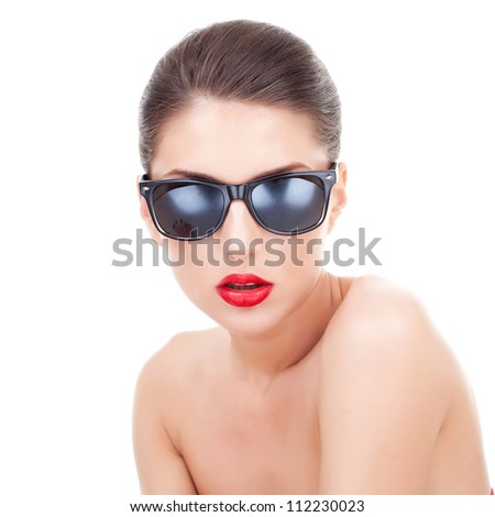 Sexy young woman with sunglasses looking at the camera, over white background - stock photo