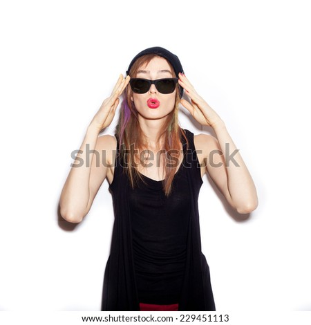 Sexy young woman with sunglasses looking at the camera.  White background, not isolated - stock photo