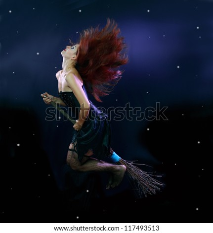 Sexywitch flying on broom on a dark sky with stars - stock photo