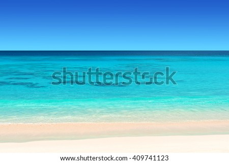 seychelles tropical beach with white sand turquoise water and blue  sky - stock photo