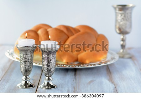 Shabbat candles with Challah bread and wine cup - stock photo
