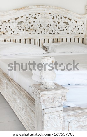 Shabby chic bedroom in a home - stock photo