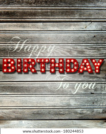Shabby chic wooden background with glowing letters writing Happy Birthday to you - stock photo