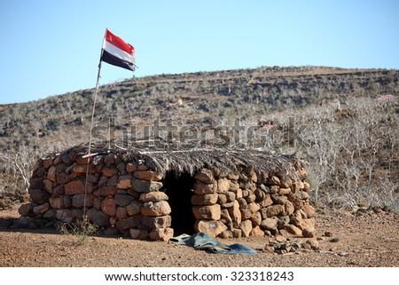 Shack with Yemeni flag  on Socotra island - stock photo