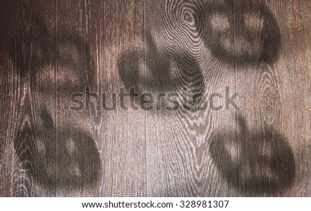 Shadoes of Halloween pumpkins on a hardwood texture - stock photo