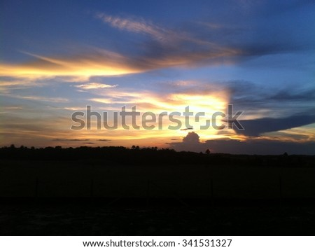 Shadow in the clouds - stock photo