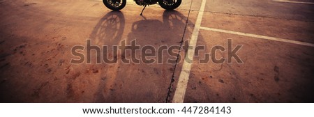 Shadow motorcycle - stock photo