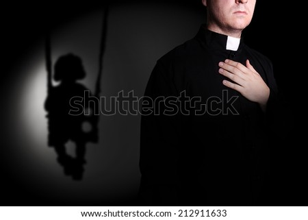 Shadow of a child on a swing, and the priest - stock photo