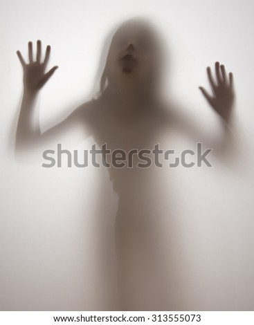 shadow of a girl behind transparent paper - stock photo