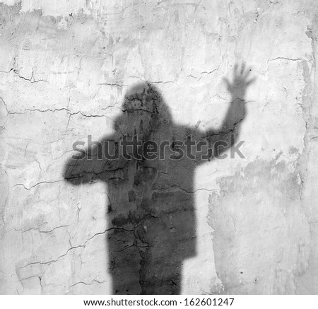 shadow of a man on the wall - stock photo
