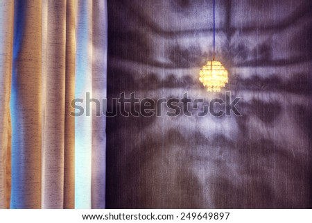 Shadow of art light reflecting on wall - stock photo