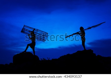 Shadow of fishing before returning home. - stock photo