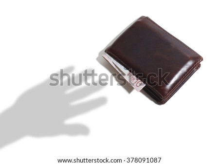 Shadow of Hand Reaching for a Leather Wallet with Euro Notes on a White Background - stock photo