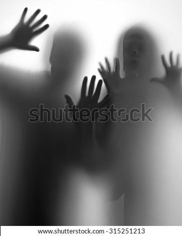 shadow of people behind transparent paper - stock photo
