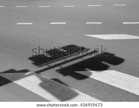 shadow of Traffic light pole on road - stock photo