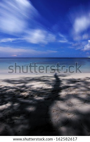Shadow of Tree at Tip of Borneo,Sabah - stock photo