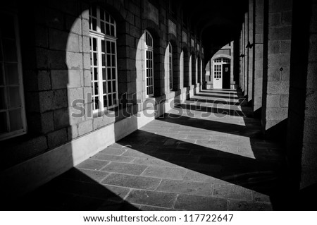 shadows and columns in historical architecture - stock photo