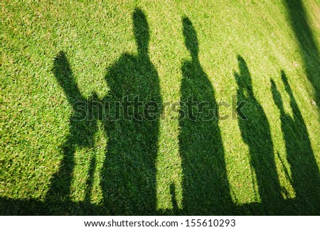 Shadows in the turf of a football pitch as photographers await the start of the Premier League match between Mosta & Balzan and Ta Qali National Stadium - stock photo