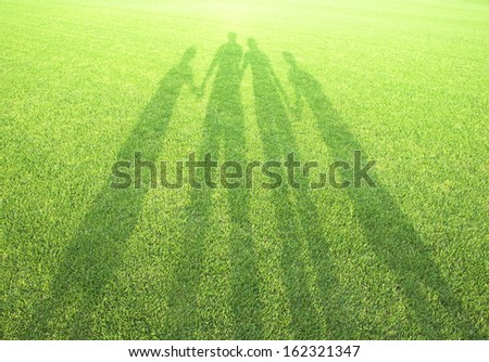 Shadows of a family - stock photo