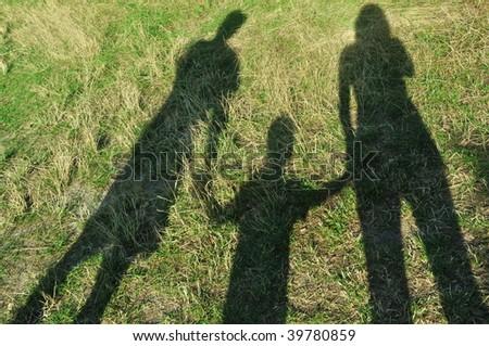 Shadows of the family - stock photo