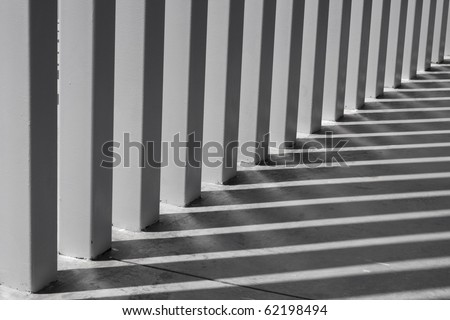 Shadows on modern columns on the floor as abstract art - stock photo