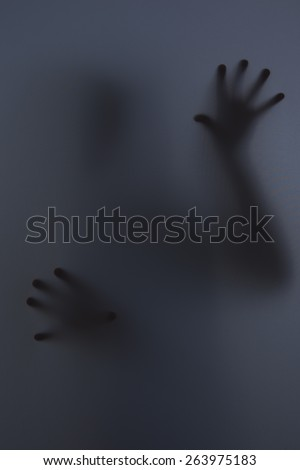 Shadowy figure behind glass / fear, panic concept - stock photo
