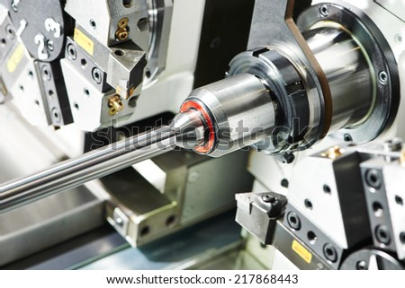 shaft detail turning on metal cutting machine tool at manufacturing factory - stock photo
