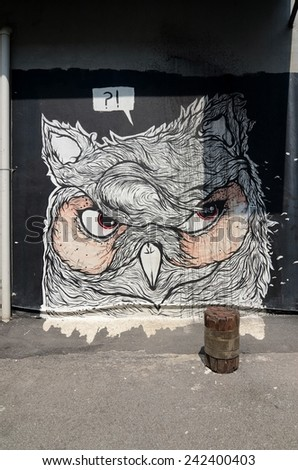 "SHAH ALAM, MALAYSIA-JANUARY 7: Street Mural tittle ""Owl"" painted by  by Cnvsstore  in Shah Alam on January 7, 2015. It was painted in conjunction with the 2014 Street Art Selangor Festival - stock photo"
