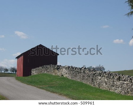 Shaker barn and stone fence Pleasant Hill, Kentucky - stock photo