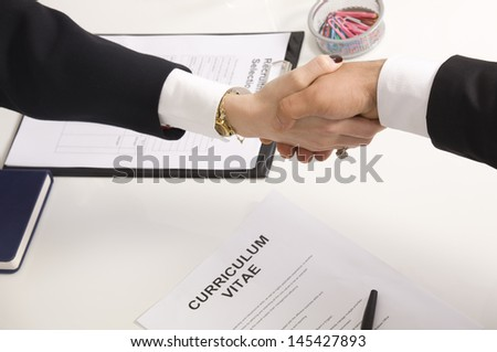 shaking hands with manager at job interview closeup - stock photo