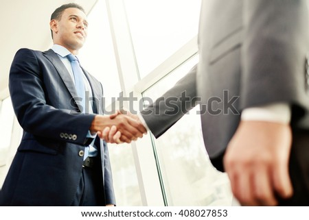 Shaking hands with partner - stock photo