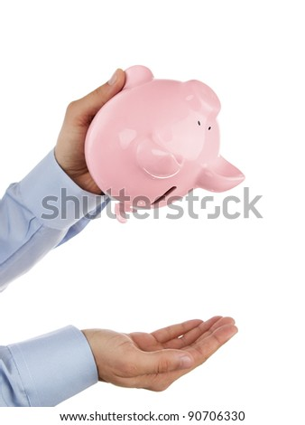 Shaking out empty piggy bank - stock photo
