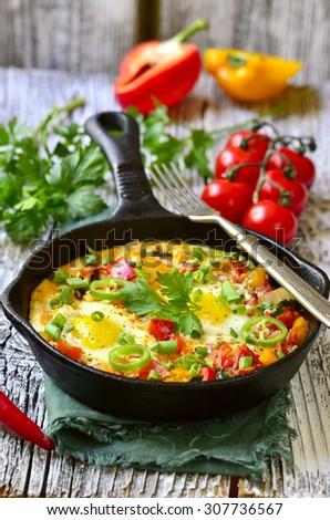 Shakshuka - traditional dish of israeli cuisine in a skillet pan. - stock photo