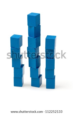Shaky towers representing growth, learning curve, achievement - stock photo