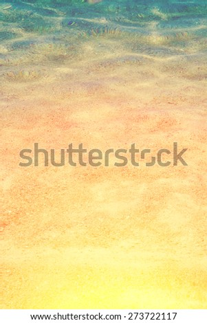Shallow clear sea water by the sand shore - stock photo