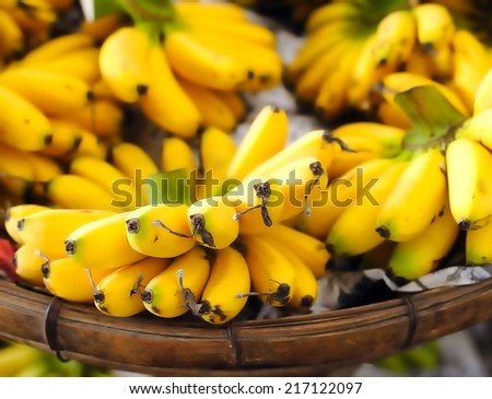 Shallow depth of field photography of ripe yellow bananas on local street market in Asia - stock photo