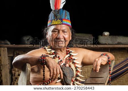 Shaman in Ecuadorian Amazonia during a real ayahuasca ceremony - stock photo