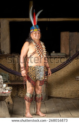 Shaman in Ecuadorian Amazonia during a real ayahuasca ceremony, model released image, as seen in April 2015 - stock photo
