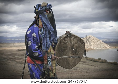 Shaman performs ritual in fog. Authentic photography. Buryatia - Mongolia - stock photo