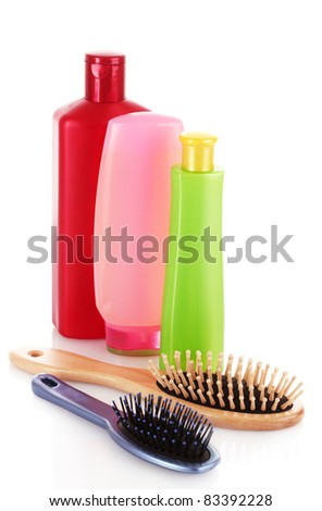 Shampoo bottles and hair brush on white - stock photo