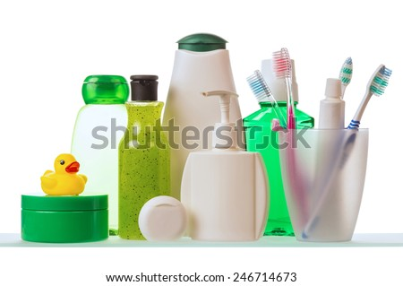 Shampoo, dental floss and toothpaste with toothbrushes isolated on white background - stock photo