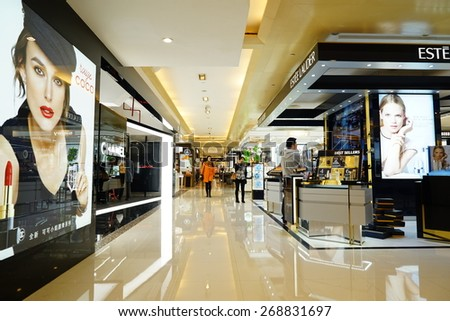 SHANGHAI-APR. 5, 2015. Luxury shopping mall interior. China accounts for about 20 percent, or 180 billion renminbi ($27 billion ) of global luxury sales in 2015, according to new McKinsey research.  - stock photo