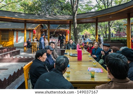 SHANGHAI - APRIL 7: people sitting drinking discussing in gucheng park on april 7th, 2013 in Shanghai - stock photo